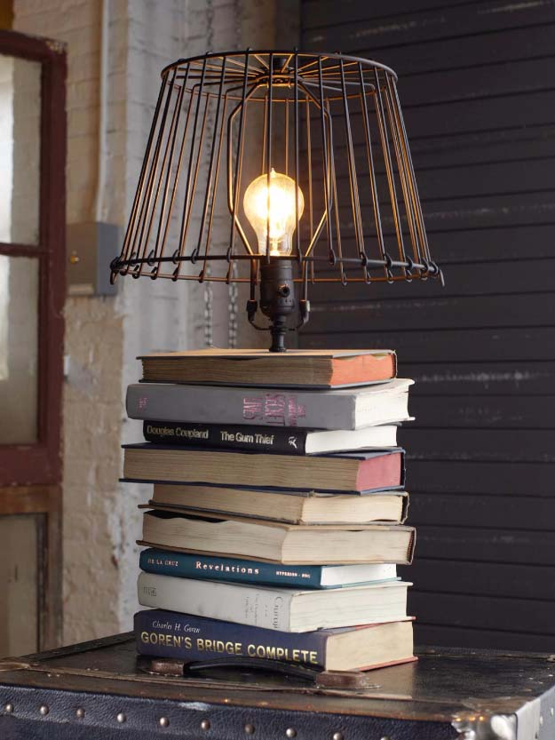 DIY Lighting Ideas and Cool DIY Light Projects for the Home. Chandeliers, lamps, awesome pendants and creative hanging fixtures,  complete with tutorials with instructions | Stacked Books Table Lamp | http://diyjoy.com/diy-projects-lighting-ideas