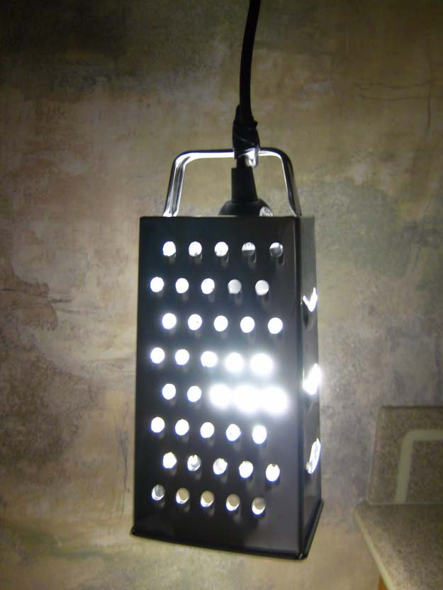 DIY Lighting Ideas and Cool DIY Light Projects for the Home. Chandeliers, lamps, awesome pendants and creative hanging fixtures,  complete with tutorials with instructions | Upcycled Cheese Grater DIY Pendant Light | http://diyjoy.com/diy-projects-lighting-ideas