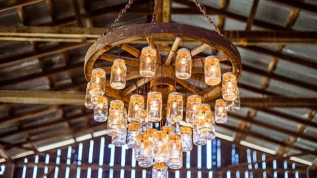 DIY Chandelier Ideas and Project Tutorials - DIY Lighting Ideas and Cool DIY Light Projects for the Home. Chandeliers, lamps, awesome pendants and creative hanging fixtures, complete with tutorials with instructions | Wagon Wheel Mason Jar Chandelier | http://diyjoy.com/diy-projects-lighting-ideas - Easy Makeover Tips, Rustic Pipe, Crystal, Rustic, Mason Jar, Beads. Bedroom, Outdoor and Wedding Girls Room Lighting Ideas With Step by Step Instructions