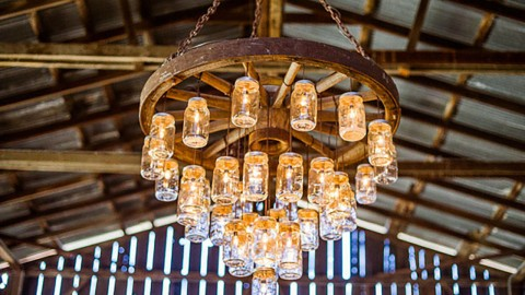 Wagon Wheel Chandelier Made with Mason Jars   DIY Joy Projects and Crafts Ideas