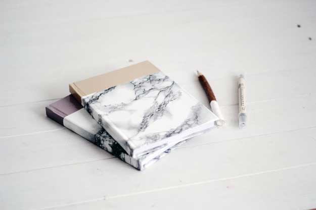 27 MORE Expensive Looking DIY Gifts. Crafts and DIY Gift Ideas for Him, for Her, for Family and Friends. Perfect for Birthday, Christmas, Mom and Dad. | DIY Marbled Notebook | http://diyjoy.com/homemade-diy-gifts-pinterest