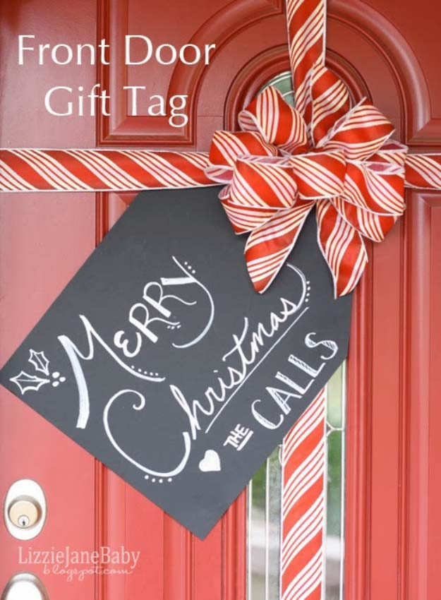 Awesome DIY Christmas Home Decorations and Homemade Holiday Decor Ideas - Quick and Easy Decorating ideas, cool ornaments, home decor crafts and fun Christmas stuff | Crafts and DIY projects by DIY Joy | Gift Wrapped Front Door with Tag | http://diyjoy.com/diy-christmas-decor-holiday-decorations