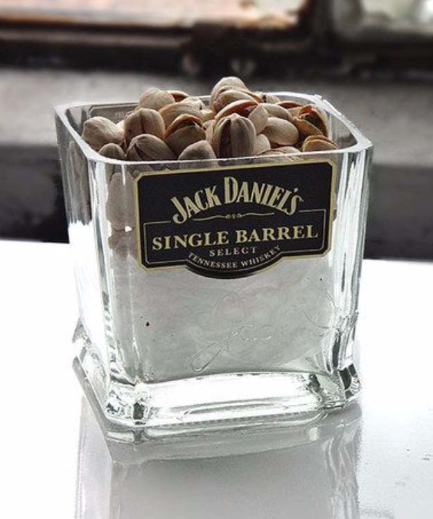 Fun DIY Ideas Made With Jack Daniels - Recipes, Projects and Crafts With The Bottle, Everything From Lamps and Decorations to Fudge and Cupcakes | Jack Daniels Single Barrel Nuts or Candy Dish Cut Bottle Idea #diy #jackdaniels #recipes #crafts