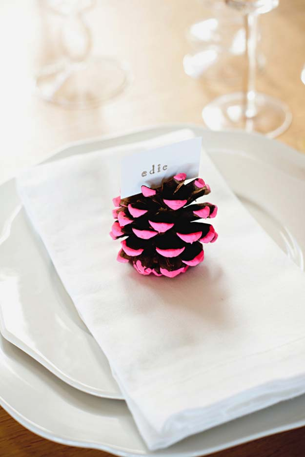 Awesome DIY Christmas Home Decorations and Homemade Holiday Decor Ideas - Quick and Easy Decorating ideas, cool ornaments, home decor crafts and fun Christmas stuff | Crafts and DIY projects by DIY Joy | Neon Dipped Pine Cone Place Card Holder #diy #crafts #christmas