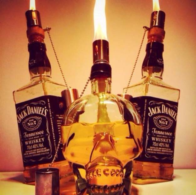 Fun DIY Ideas Made With Jack Daniels - Recipes, Projects and Crafts With The Bottle, Everything From Lamps and Decorations to Fudge and Cupcakes | Tiki Torch from a Bottle of Jack Daniels | http://diyjoy.com/diy-projects-jack-daniels