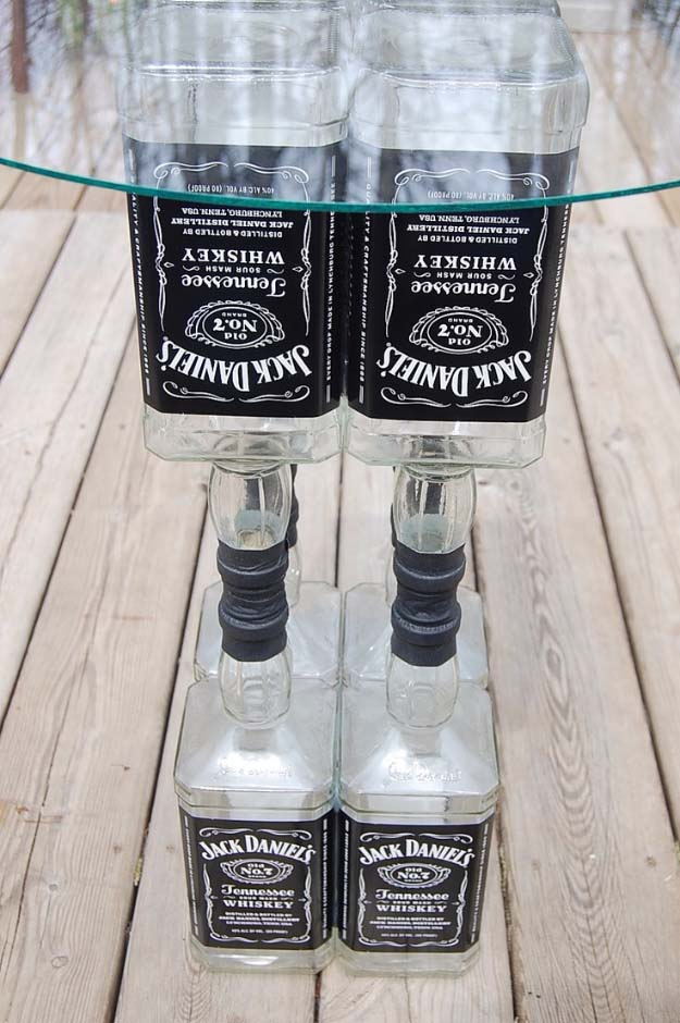 Fun DIY Ideas Made With Jack Daniels - Recipes, Projects and Crafts With The Bottle, Everything From Lamps and Decorations to Fudge and Cupcakes | Upcycled Jack Daniels Liquor Bottle Table Idea #diy #jackdaniels #recipes #crafts