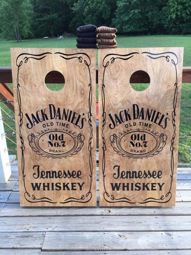 Fun DIY Ideas Made With Jack Daniels - Recipes, Projects and Crafts With The Bottle, Everything From Lamps and Decorations to Fudge and Cupcakes | Jack Daniels Inspired Stenciled Corn Hole Boards #diy #jackdaniels #recipes #crafts