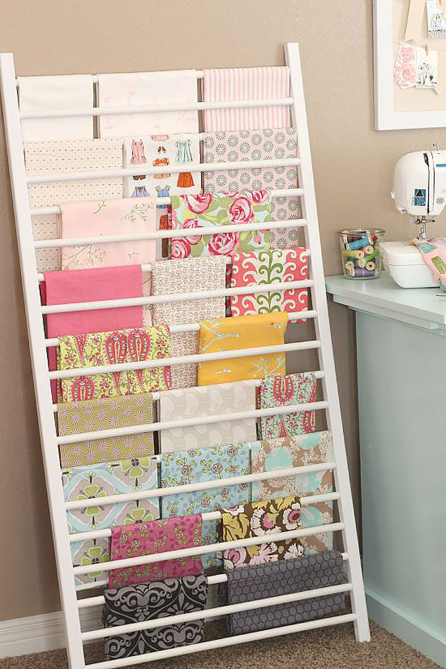 DIY Craft Room Ideas and Craft Room Organization Projects - Crib Side Repurposed into Fabric Storage - Cool Ideas for Do It Yourself Craft Storage - fabric, paper, pens, creative tools, crafts supplies and sewing notions | http://diyjoy.com/craft-room-organization