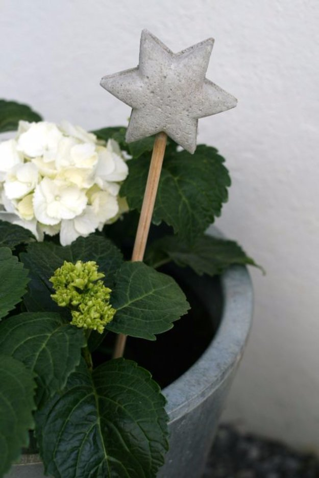 43 DIY concrete crafts - DIY Concrete Plant Stake for the Garden- Cheap and creative projects and tutorials for countertops and ideas for floors, patio and porch decor, tables, planters, vases, frames, jewelry holder, home decor and DIY gifts #gifts #diy