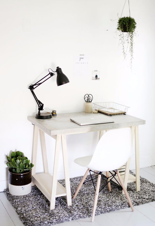 43 DIY concrete crafts - DIY Desk with Concrete Desktop and Wood Legs- Cheap and creative projects and tutorials for countertops and ideas for floors, patio and porch decor, tables, planters, vases, frames, jewelry holder, home decor and DIY gifts. http://diyjoy.com/diy-concrete-crafts-projects