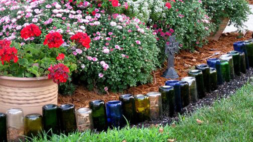Diy wine bottle edging for your garden for How to use wine bottles in the garden