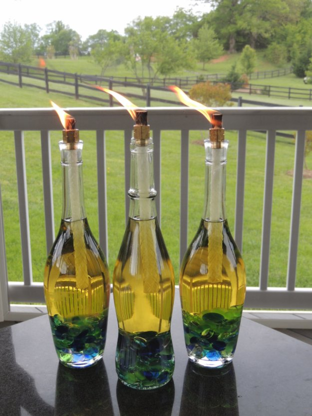 Wine Bottle DIY Crafts - Wine Bottle Tiki Torch   - Projects for Lights, Decoration, Gift Ideas, Wedding, Christmas. Easy Cut Glass Ideas for Home Decor on Pinterest http://diyjoy.com/wine-bottle-crafts