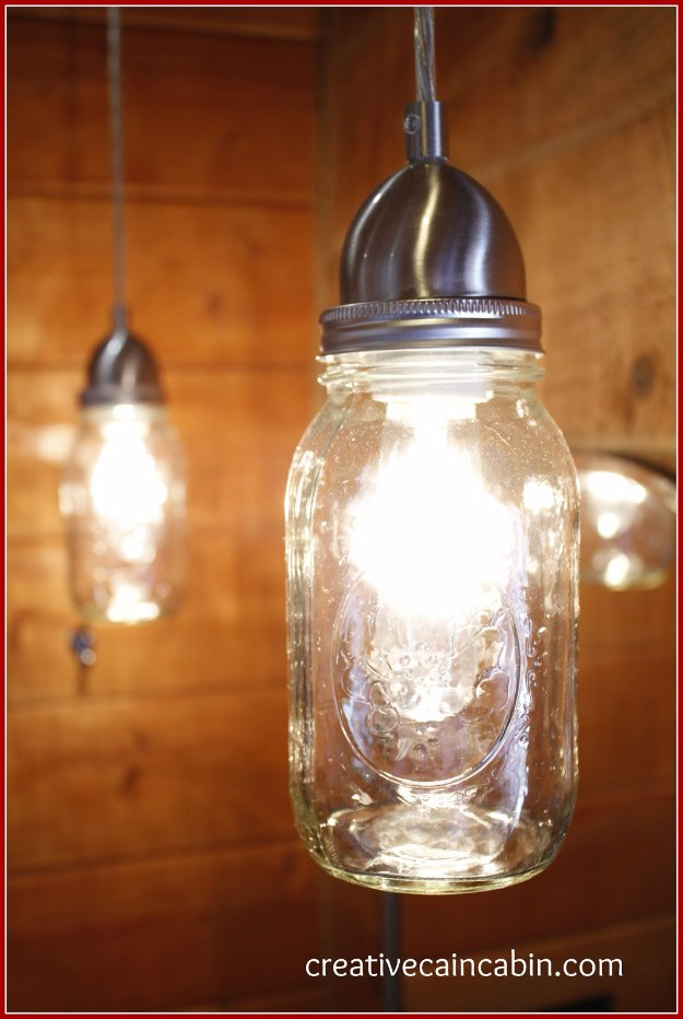 Mason Jar Lights - Mason Jar Bathroom Light - DIY Ideas with Mason Jars for Outdoor, Kitchen, Bathroom, Bedroom and Home, Wedding. How to Make Hanging Lanterns, Rustic Chandeliers and Pendants, Solar Lights for Outside http://diyjoy.com/diy-mason-jar-lights-lanterns