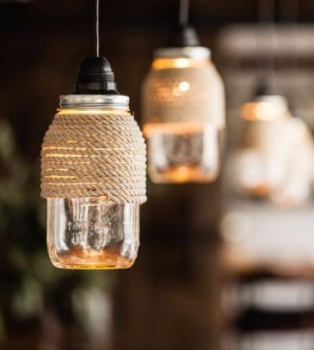 Mason Jar Lights - Rope Wrapped Mason Jar Lights - DIY Ideas with Mason Jars for Outdoor, Kitchen, Bathroom, Bedroom and Home, Wedding. How to Make Hanging Lanterns, Rustic Chandeliers and Pendants, Solar Lights for Outside http://diyjoy.com/diy-mason-jar-lights-lanterns