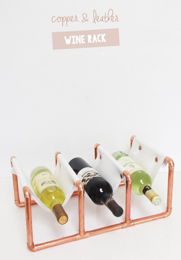 DIY Kitchen Decor Ideas - DIY Copper Pipe and Leather Wine Rack - Creative Furniture Projects, Accessories, Countertop Ideas, Wall Art, Storage, Utensils, Towels and Rustic Furnishings http://diyjoy.com/diy-kitchen-decor-ideas