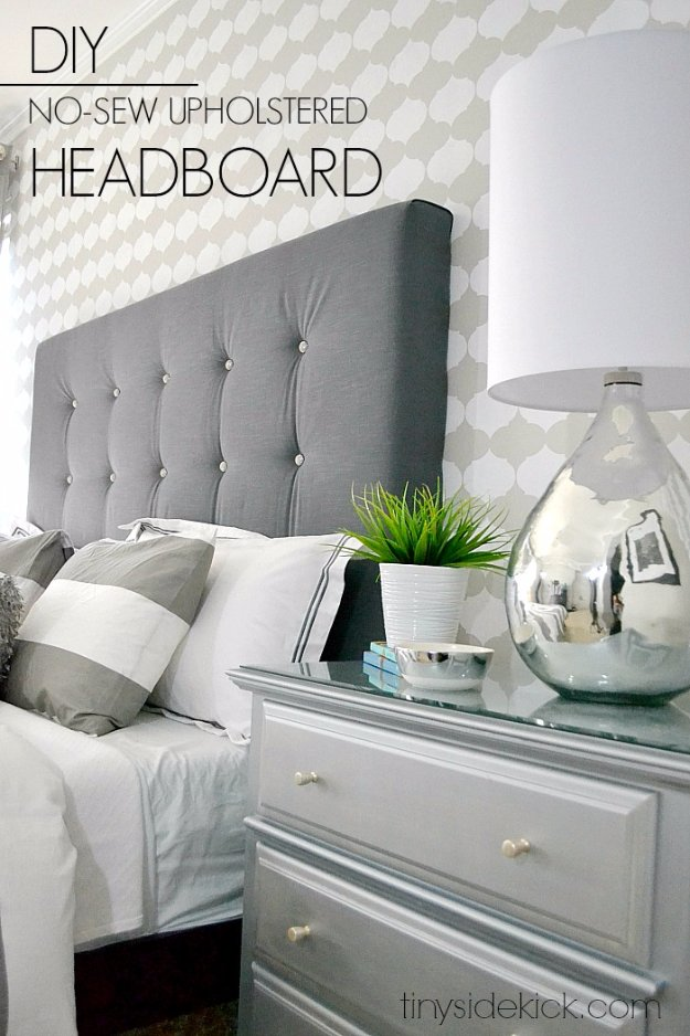 diy headboard: four boards, a sanding block, and a can of stain - hang with  large strips. simple fix until a house where a big headboard will fit :)