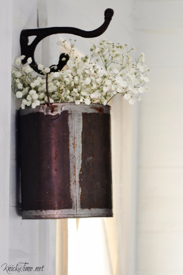DIY Farmhouse Style Decor Ideas - Repurpose a Paint Can into Hanging Flower Holder - Rustic Ideas for Furniture, Paint Colors, Farm House Decoration for Living Room, Kitchen and Bedroom http://diyjoy.com/diy-farmhouse-decor-ideas