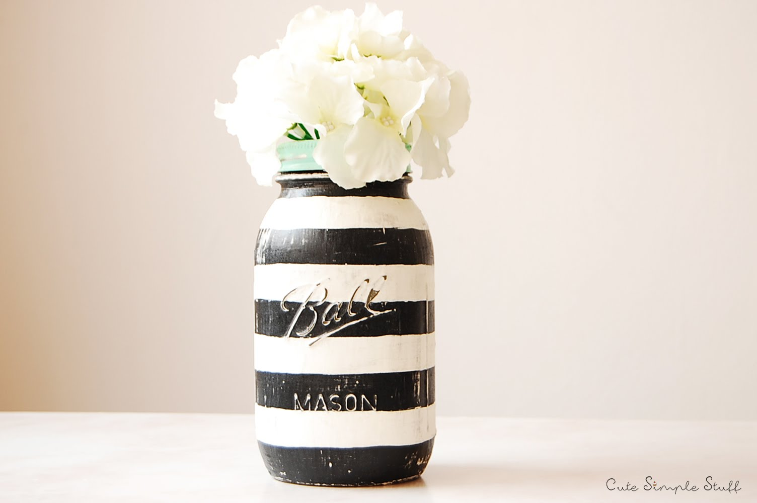 DIY Mason Jar Vases - Artsy Striped Mason Jar is The Bomb!  Easy! - Best Vase Projects and Ideas for Mason Jars - Painted, Wedding, Hanging Flowers, Centerpiece, Rustic Burlap, Ribbon and Twine http://diyjoy.com/diy-mason-jar-vases