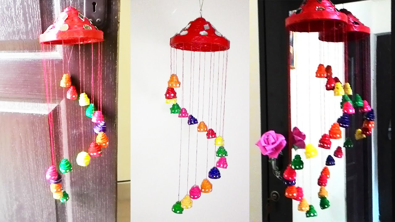 DIY Wind Chimes - Easy DIY Festive Newspaper Wall Hanging or Wind Chimes - Easy, Creative and Cool Windchimes Made from Wooden Beads, Pipes, Rustic Boho and Repurposed Items, Silverware, Seashells and More. Step by Step Tutorials and Instructions #windchimes #diygifts #diyideas #crafts