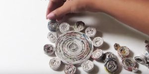 She Rolls Up Strips Of Newspaper And Watch the Attractive Piece She Makes! (OUTSTANDING!)