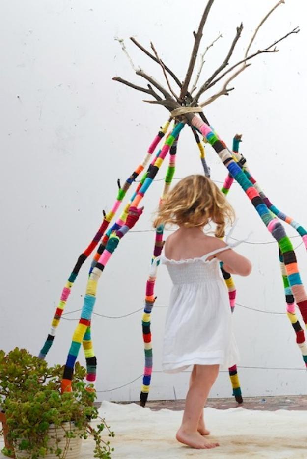 Clever DIYs Made With Yarn - Yarn Wrapped Stick Teepee - Yarn Crafts To Try, Easy Yarn DIYs, Fun Crafts To Do With Yarn, Wall Art, Awesome Yarn Ideas, Yarn DIY Projects, Brillian Yarn Craft Tutorials http://diyjoy.com/diy-curtains-drapes