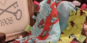 She Makes An Adorable Busy Tag Baby Blanket For A Special Baby Gift