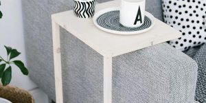 He Makes A Special Table To Go Over The Arm Of A Sofa (So Brilliant!)