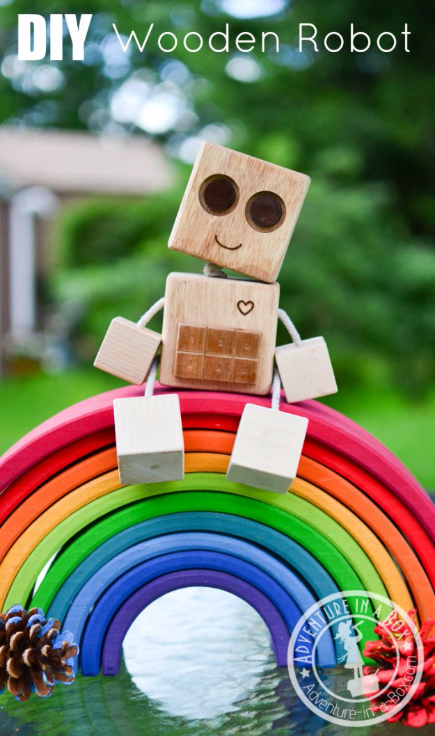 Crafts For Kids To Make At Home - DIY Wooden Robot - Cheap DIY Projects and Fun Craft Ideas for Children - Cute Paper Crafts, Fall and Winter Fun, Things For Toddlers, Babies, Boys and Girls to Make At Home http://diyjoy.com/diy-ideas-for-kids-to-make