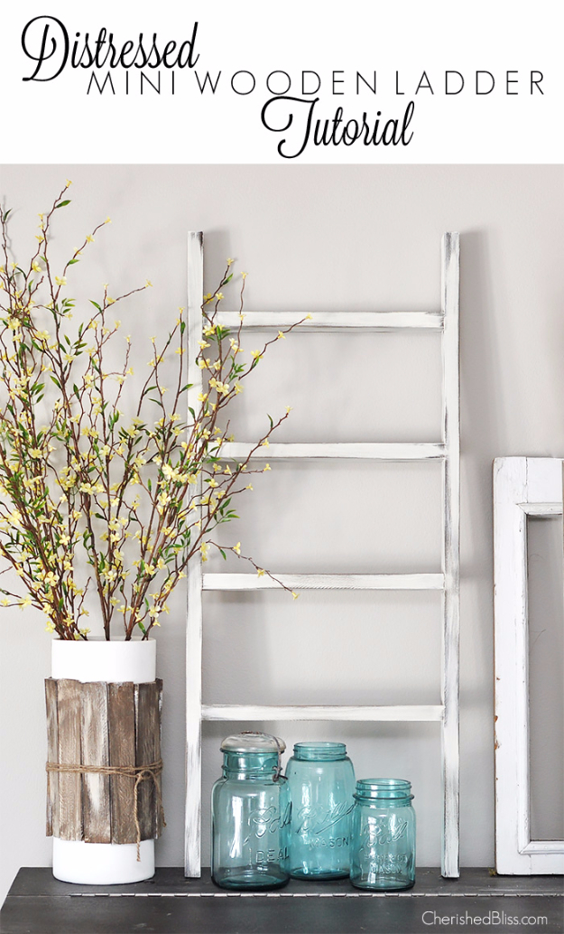 DIY Farmhouse Style Decor Ideas for the Bedroom - Distressed Mini Wooden Ladder - Rustic Farm House Ideas for Furniture, Paint Colors, Farm House Decoration for Home Decor in The Bedroom - Wall Art, Rugs, Nightstands, Lights and Room Accessories http://diyjoy.com/diy-farmhouse-decor-bedroom