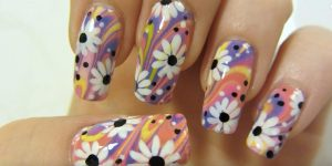 Watch How She Does This Colorful Flower Design with Water Marbling Nail Art!