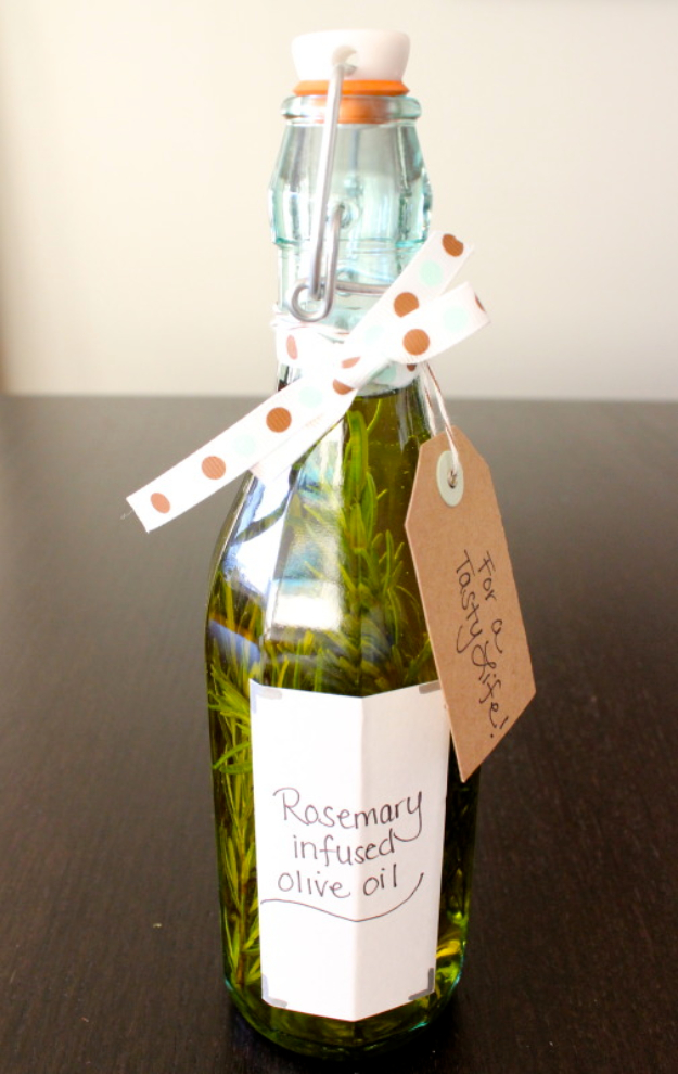 DIY Housewarming Gifts - Rosemary Infused Olive Oil - Best Do It Yourself Gift Ideas for Friends With A New House, Home or Apartment - Creative, Cheap and Quick Crafts and DIY Ideas for Housewarming Presents - Mason Jar Gifts, Baskets, Gifts for Women and Men #diygifts #housewarming #diyideas #cheapgifts