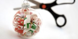 She Shows Us How To Make Easy Ornaments By Curling Wrapping Paper and Putting It Inside Clear Balls!