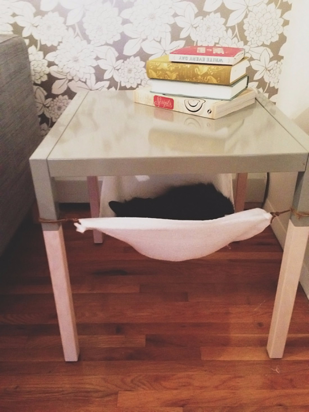 DIY Cat Hacks - Create An Under Table Cat Hammock - Tips and Tricks Ideas for Cat Beds and Toys, Homemade Remedies for Fleas and Scratching - Do It Yourself Cat Treat Recips, Food and Gear for Your Pet - Cool Gifts for Cats http://diyjoy.com/diy-cat-hacks