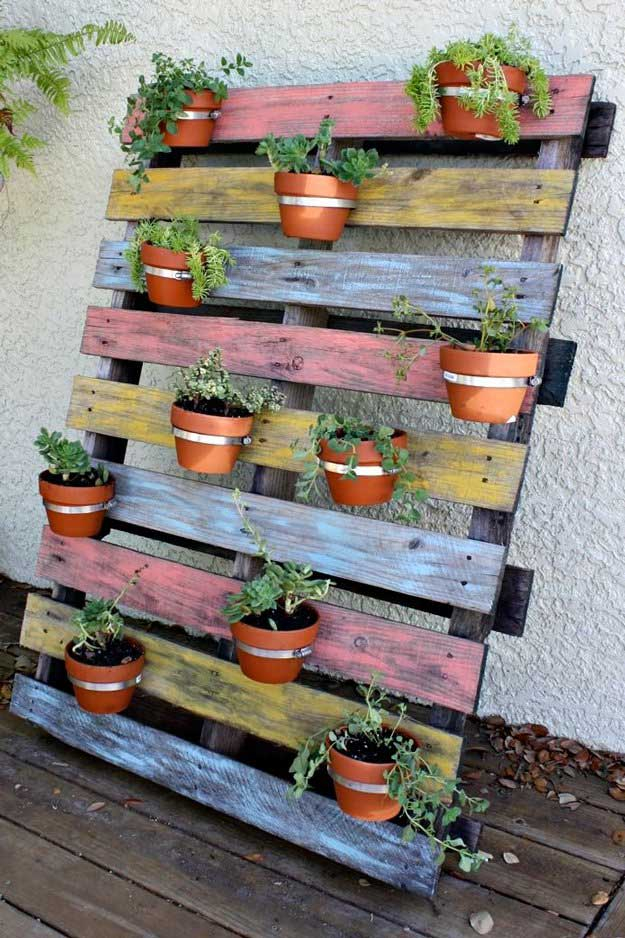 Best DIY Pallet Furniture Ideas - Vertical Pot Pallet Planter - Cool Pallet Tables, Sofas, End Tables, Coffee Table, Bookcases, Wine Rack, Beds and Shelves - Rustic Wooden Pallet Furniture Made Easy With Step by Step Tutorials - Quick DIY Projects and Crafts by DIY Joy http://diyjoy.com/best-diy-pallet-furniture-ideas