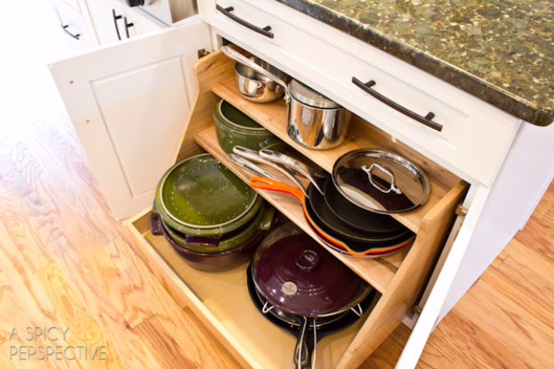 DIY Organizing Ideas for Kitchen - Install A Roll Out Organizer - Cheap and Easy Ways to Get Your Kitchen Organized - Dollar Tree Crafts, Space Saving Ideas - Pantry, Spice Rack, Drawers and Shelving - Home Decor Projects for Men and Women http://diyjoy.com/diy-organizing-ideas-kitchen