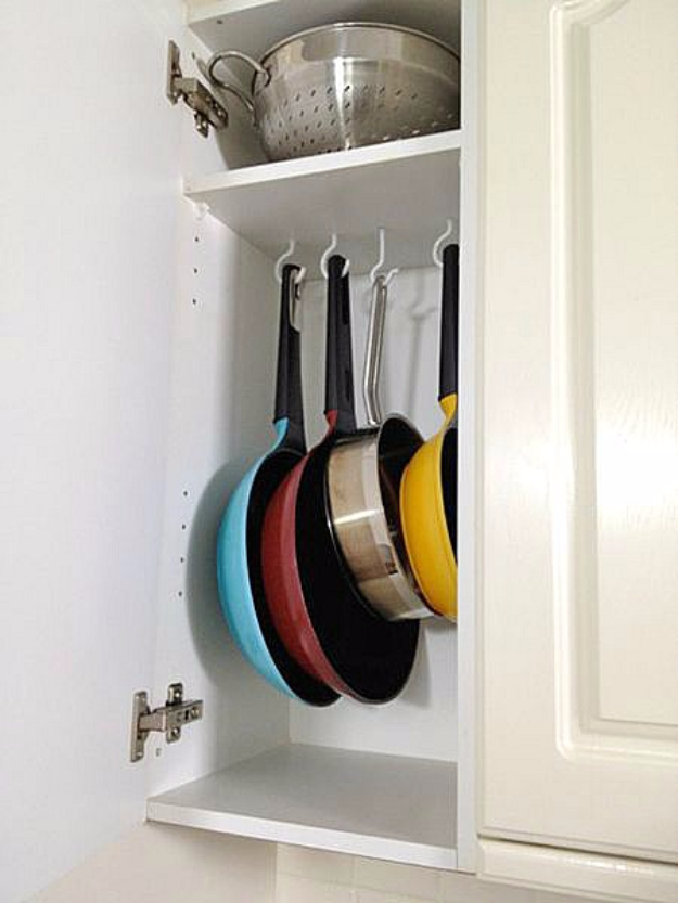 DIY Organizing Ideas for Kitchen - Tension Rods And Shower Hooks As Pot Organizer - Cheap and Easy Ways to Get Your Kitchen Organized - Dollar Tree Crafts, Space Saving Ideas - Pantry, Spice Rack, Drawers and Shelving - Home Decor Projects for Men and Women #diykitchen #organizing #diyideas #diy