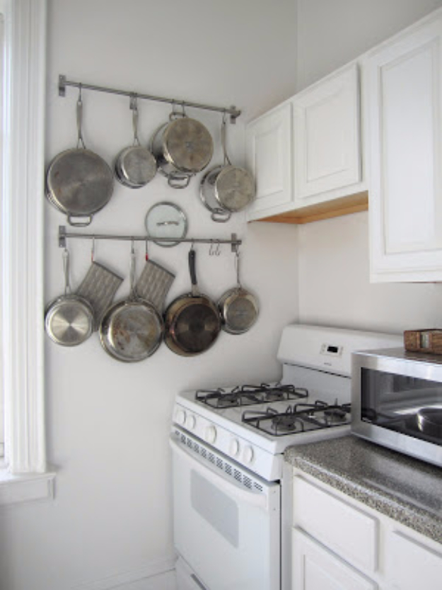 DIY Organizing Ideas for Kitchen - Use Nifty Rails To Hang Pots And Pans - Cheap and Easy Ways to Get Your Kitchen Organized - Dollar Tree Crafts, Space Saving Ideas - Pantry, Spice Rack, Drawers and Shelving - Home Decor Projects for Men and Women #diykitchen #organizing #diyideas #diy