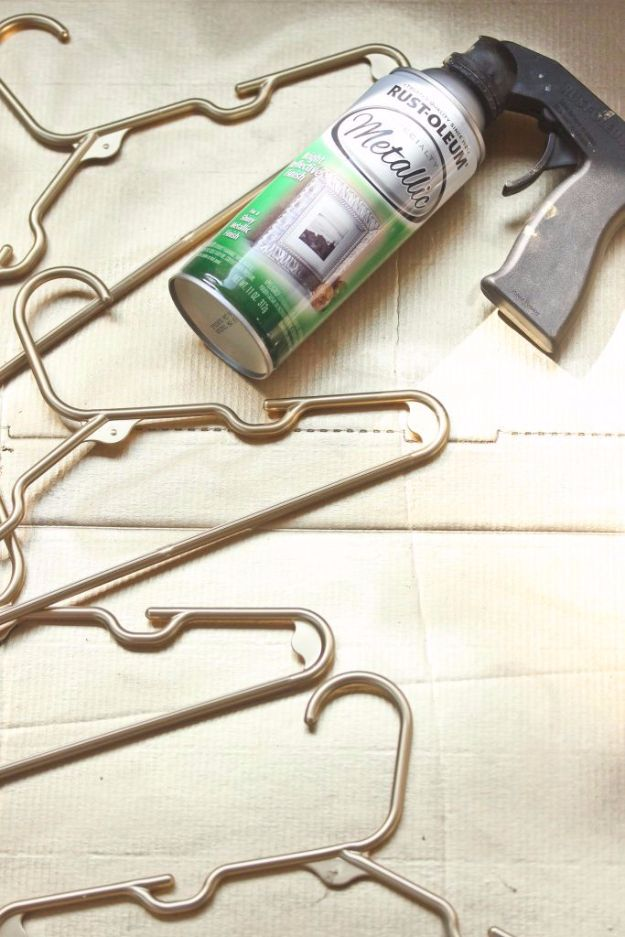 Spray Painting Tips and Tricks - DIY Gold Plastic Hangers - Home Improvement Ideas and Tutorials for Spray Painting Furniture, House, Doors, Trim, Windows and Walls - Step by Step Tutorials and Best How To Instructions - DIY Projects and Crafts by DIY JOY http://diyjoy.com/spray-painting-tips-tricks