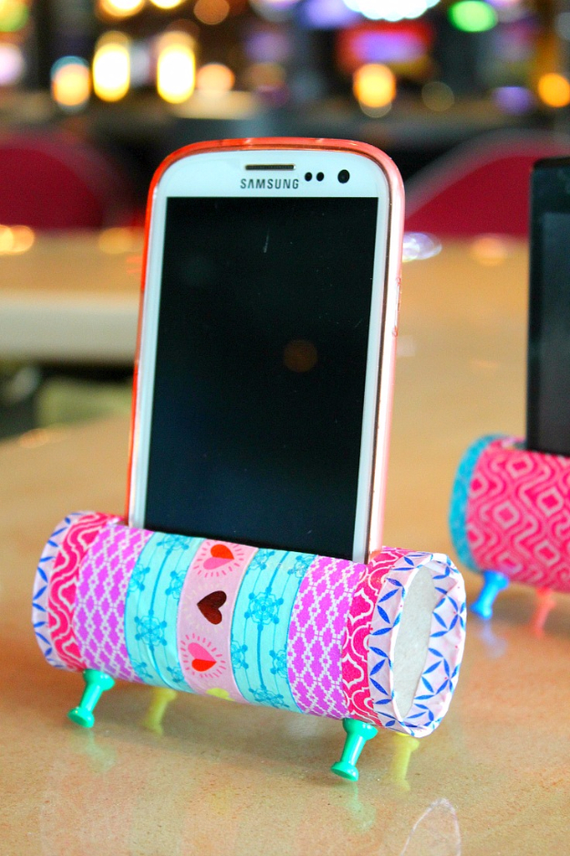 DIY Phone Hacks - DIY Phone Stand From Recyled Toilet Paper Rolls - Cool Tips and Tricks for Phones, Headphones and iPhone How To - Make Speakers, Change Settings, Know Secrets You Can Do With Your Phone By Learning This Cool Stuff - DIY Projects and Crafts for Men and Women http://diyjoy.com/diy-iphone-hacks