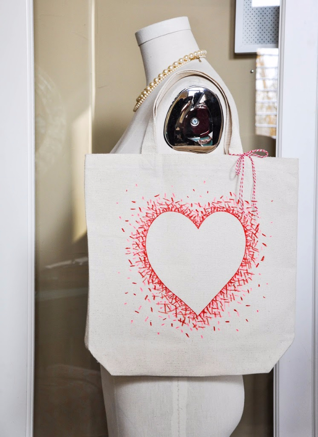 DIY Sharpie Crafts - Negative Space Heart Bag - Cool and Easy Craft Projects and DIY Ideas Using Sharpies - Use Markers To Decorate and Design Home Decor, Cool Homemade Gifts, T-Shirts, Shoes and Wall Art. Creative Project Tutorials for Teens, Kids and Adults http://diyjoy.com/diy-sharpie-crafts