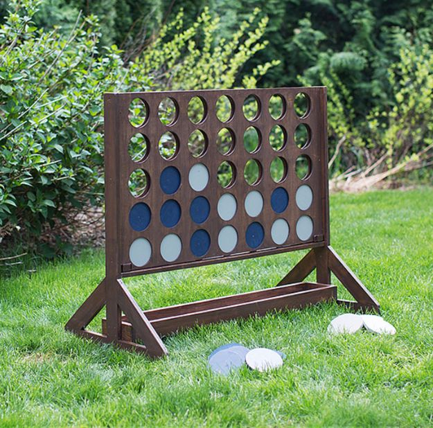 Best DIY Backyard Games - DIY Backyard Game Four In A Row - Cool DIY Yard Game Ideas for Adults, Teens and Kids - Easy Tutorials for Cornhole, Washers, Jenga, Tic Tac Toe and Horseshoes - Cool Projects for Outdoor Parties and Summer Family Fun Outside #diy #backyard #kids #games
