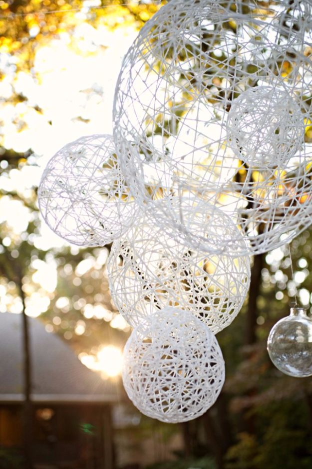 DIY Outdoors Wedding Ideas - DIY Twine Lanterns - Step by Step Tutorials and Projects Ideas for Summer Brides - Lighting, Mason Jar Centerpieces, Table Decor, Party Favors, Guestbook Ideas, Signs, Flowers, Banners, Tablecloth #wedding #diy