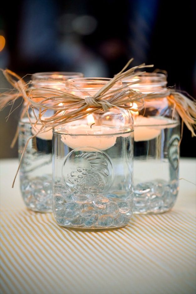 DIY Outdoors Wedding Ideas - Floating Candle Mason Jar Centerpiece - Step by Step Tutorials and Projects Ideas for Summer Brides - Lighting, Mason Jar Centerpieces, Table Decor, Party Favors, Guestbook Ideas, Signs, Flowers, Banners, Tablecloth and Runners, Napkins, Seating and Lights - Cheap and Ideas DIY Decor for Weddings http://diyjoy.com/diy-outdoor-wedding