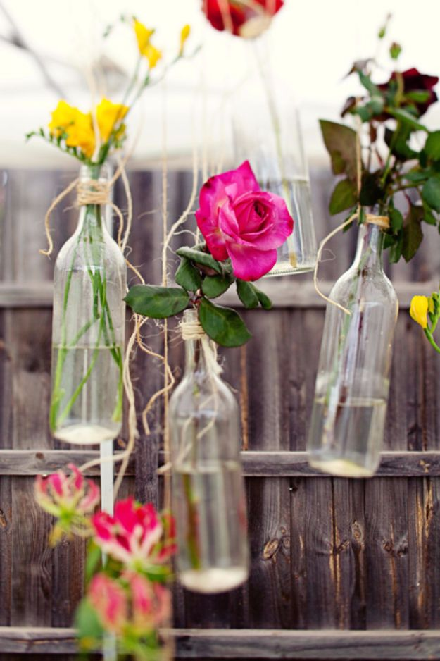 DIY Outdoors Wedding Ideas - Old Wine Bottles Wedding Floral Arrangement - Step by Step Tutorials and Projects Ideas for Summer Brides - Lighting, Mason Jar Centerpieces, Table Decor, Party Favors, Guestbook Ideas, Signs, Flowers, Banners, Tablecloth #wedding #diy