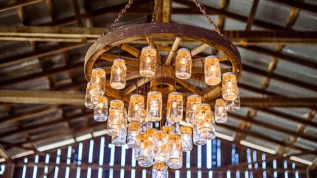 DIY Outdoors Wedding Ideas - Wagon Wheel Chandelier Made With Mason Jars - Step by Step Tutorials and Projects Ideas for Summer Brides - Lighting, Mason Jar Centerpieces, Table Decor, Party Favors, Guestbook Ideas, Signs, Flowers, Banners, Tablecloth #wedding #diy