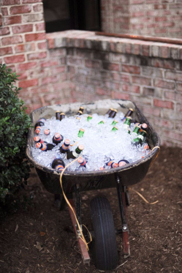 DIY Outdoors Wedding Ideas - Wheelbarrow Cooler - Step by Step Tutorials and Projects Ideas for Summer Brides - Lighting, Mason Jar Centerpieces, Table Decor, Party Favors, Guestbook Ideas, Signs, Flowers, Banners, Tablecloth #wedding #diy