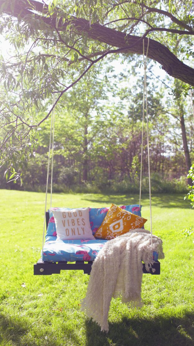 DIY Swings - DIY Outdoor Pallet Swing - Best Do It Yourself Swing Projects and Tutorials for Tire, Rocking, Hanging, Double Seat, Porch, Patio and Yard. Easy Ideas for Kids and Adults - Make The Best Backyard Ever This Summer With These Awesome Seating and Play Ideas for Swings - Creative Home Decor and Crafts by DIY JOY http://diyjoy.com/diy-swings
