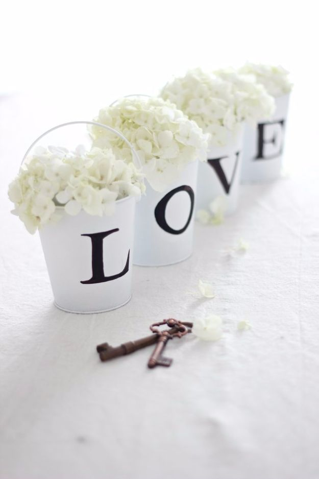 DIY Wedding Centerpieces - LOVE Tin Pail Flower Arrangement - Do It Yourself Ideas for Brides and Best Centerpiece Ideas for Weddings - Step by Step Tutorials for Making Mason Jars, Rustic Crafts, Flowers, Modern Decor, Vintage and Cheap Ideas for Couples on A Budget Outdoor and Indoor Weddings http://diyjoy.com/diy-wedding-centerpieces