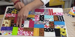 She Makes A Scrappy Quilt, An All Time Favorite, And It's A Great Beginner Project!