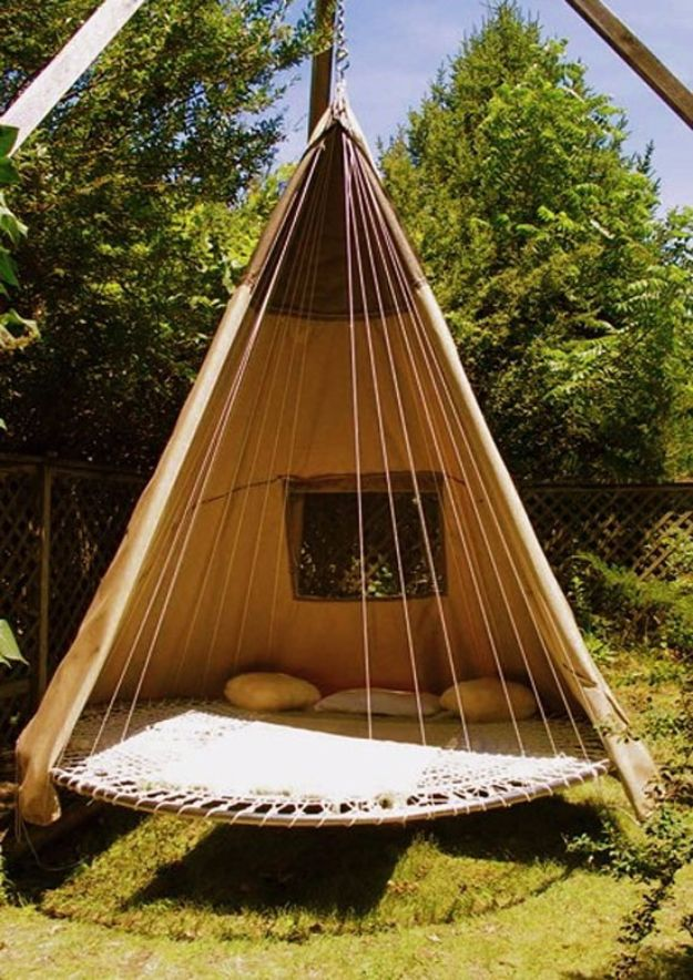 DIY Swings - Swinging Bed Made With a Recycled Trampoline - Best Do It Yourself Swing Projects and Tutorials for Tire, Rocking, Hanging, Double Seat, Porch, Patio and Yard. Easy Ideas for Kids and Adults - Make The Best Backyard Ever This Summer With These Awesome Seating and Play Ideas for Swings - Creative Home Decor and Crafts by DIY JOY
